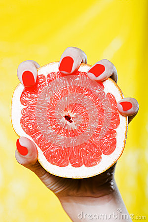Free Woman Hand Holding A Grapefruit Royalty Free Stock Photos - 37006928
