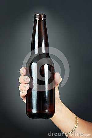 Woman hand holding beer