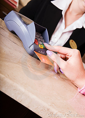 Woman hand holding credit card in payment terminal