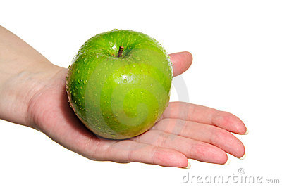 Woman hand holding fresh green apple