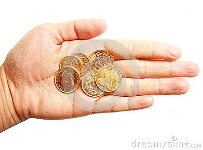 Woman hand holding gold coins on isolated white