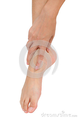Free Woman Hand Holding Her Beautiful Healthy Foot And Massaging Ankle In Pain Area. Royalty Free Stock Photography - 85893527