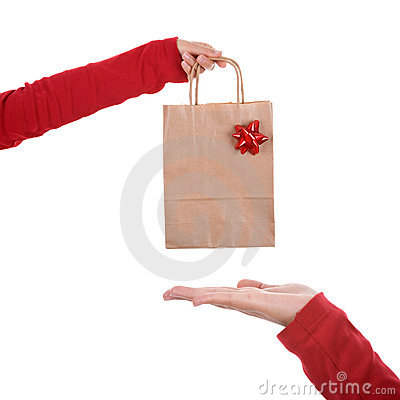 Woman hand holding papper bag with red ribbon