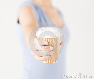 Woman hand holding take away coffee cup Stock Photo