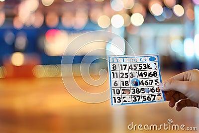 Woman hand holds bingo card