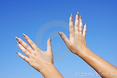 Woman hand with a manicure on a backgrou