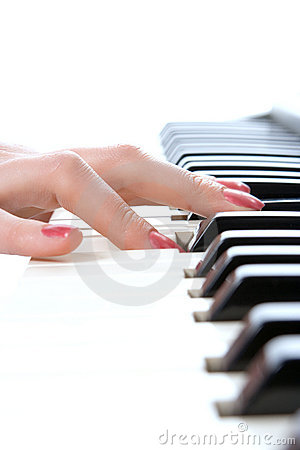 Woman hand play piano keyboard
