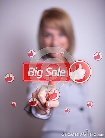 Woman hand pressing BIG SALE button