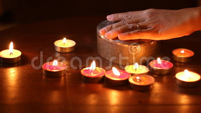 woman hand put out candle light stock footage video. Black Bedroom Furniture Sets. Home Design Ideas