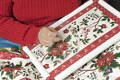 A woman hand quilting