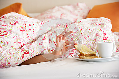 Woman Hand Reaching From Under Duvet