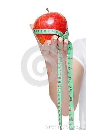 Woman hand with red apple and measure tape isolated