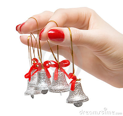 Woman hand with small bells on fingers