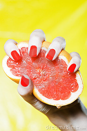 Free Woman Hand Squeezing A Grapefruit Royalty Free Stock Image - 21470706