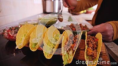 Woman hand stuffing hard taco shells - slow motion stock video