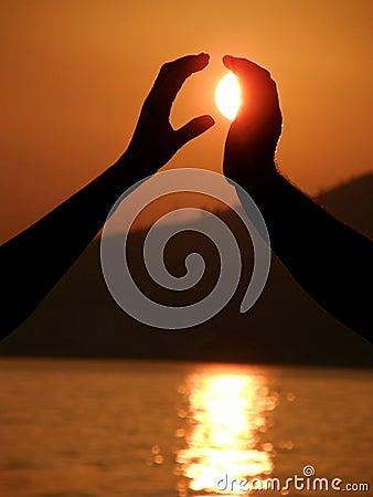 Woman hand take a sun from man