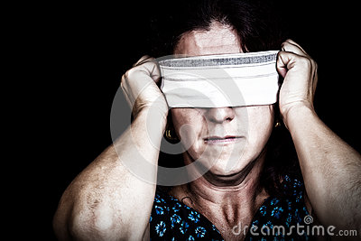Woman with a handkerchief covering her eyes