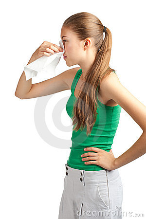 Woman with handkerchief sneezing