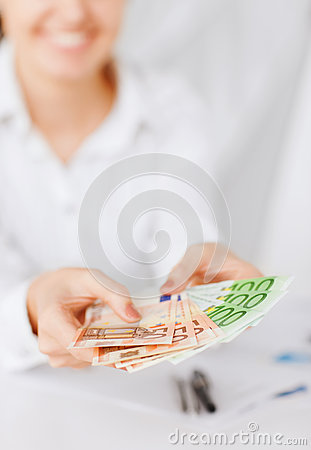 Woman hands with euro cash money
