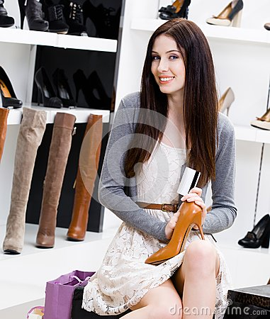 Woman hands footwear and credit card