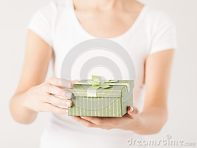 Woman hands with gift box