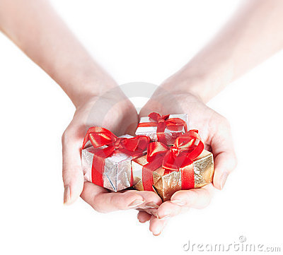 Woman hands giving gifts isolated on white