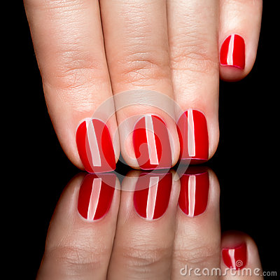 Woman hands with manicured red nails closeup.