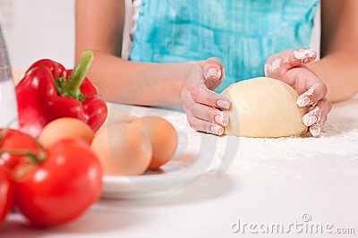 Woman hands mixing dough on the table