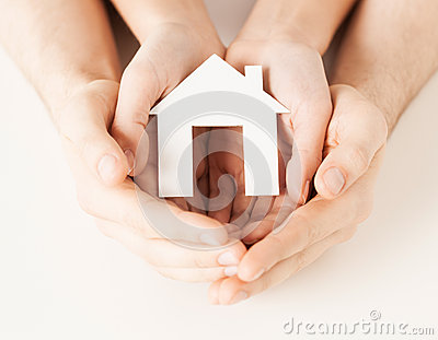 Woman and hands with paper house