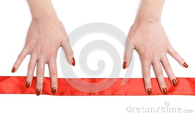 Woman hands with red ribbon