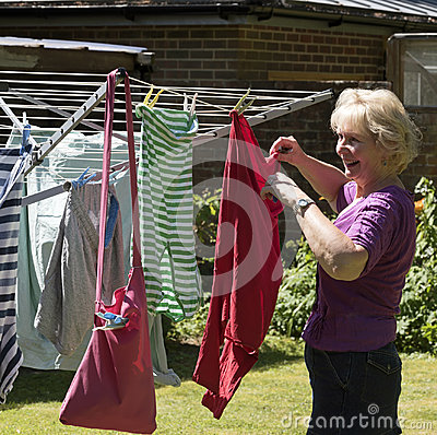 Free Woman Hanging Washing Out To Dry Stock Photo - 96312320