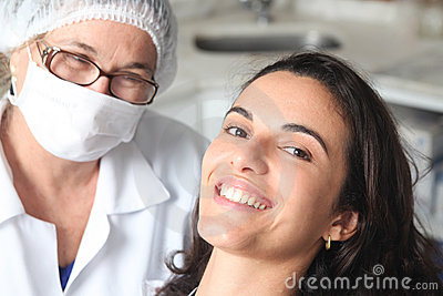 Woman happy with dentist