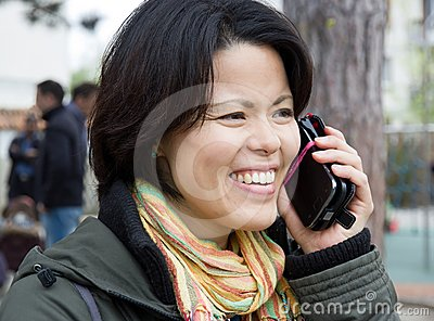 Woman happy and dynamic on the phone