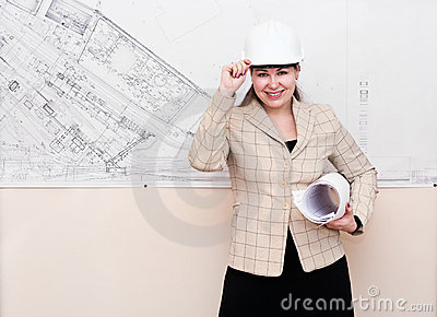 Woman in hard hat with blueprints