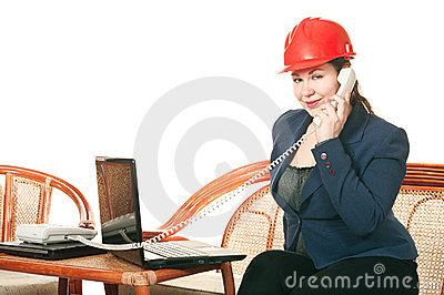 Woman in hard hat calling by phone