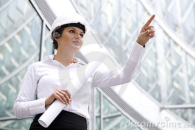 Woman in hardhat pointing finger