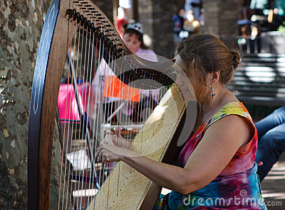 Woman Harpist Editorial Photo