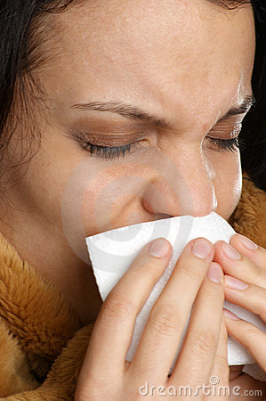 woman has a cold and one tissue