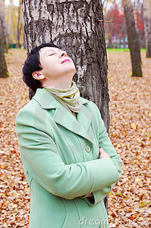 Woman has a rest in autumn park