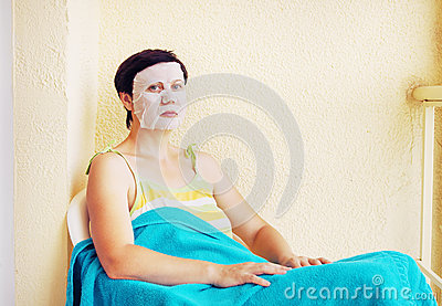 Woman has a rest with a cosmetic mask