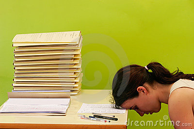 Woman has stress because of huge work on her desk