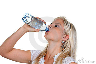 Woman has a thirst and drinking mineral water