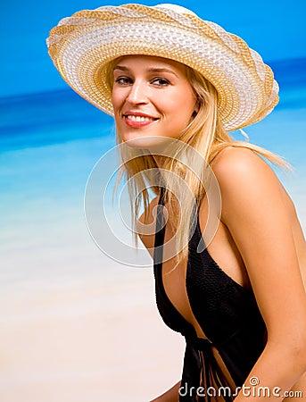Woman in hat and bikini