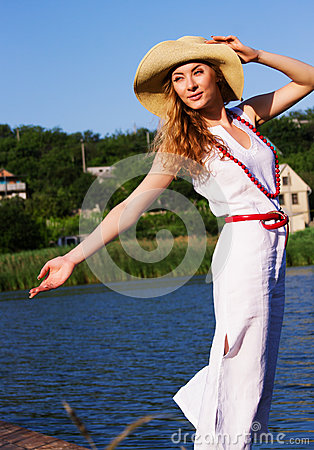 Woman in hat enjoying wind