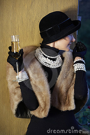 Woman in hat, fur and champagne