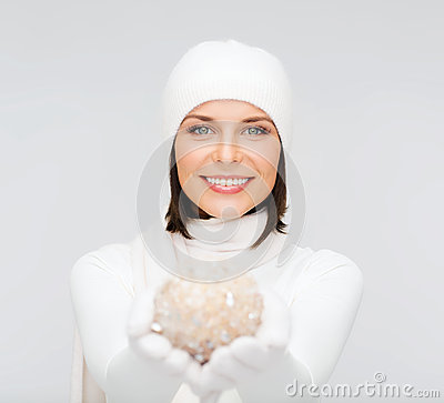 Woman in hat and gloves with christmas ball