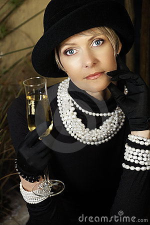 Woman In Hat Pearls And Champagne Stock Photography