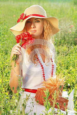 Woman in hat with poppy bouquet