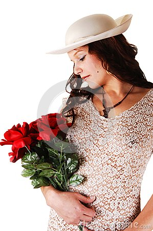 Woman with hat and red roses.