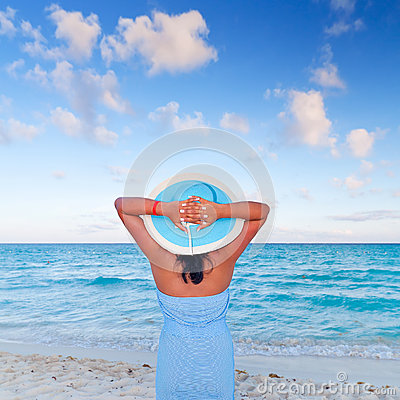 Woman in hat relaxing at Caribbean Sea